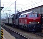 br-218-v-164-2/179735/218-387-9-und-23-042-mit 218 387-9 und 23 042 mit Personenzug bei der Duchfahrt durch den Hbf Trier am 03.04.2010.  Beide Loks wurden bei  Henschel in Kassel gebaut. Die 218 31845 im Jahr 1975, die 23 042 unter der Fabriknummer 28542 im Jahr 1954.