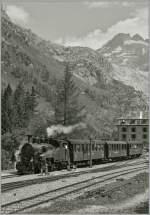 DFB Dampfbahn Furka Bergstrecke/284714/die-hg-34-n-1-furkahorn Die HG 3/4 N° 1 'Furkahorn' erreicht von Realp kommend, Gletsch.  5. VIII. 13