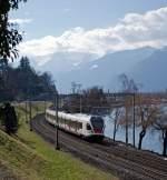 rabe-523-stadler-flirt/183999/stadler-flirt-rabe-523-024-der Stadler FLIRT  RABe 523 024 der SBB (RER Vaudois) als S1 (Villeneuve - Montreux -  Vevey - Lausanne -  Yverdon-les-Bains),fährt am 26.02.2012 bei  Clos du Moulin am Genfersee Richtung Lausanne. Hier blicken wir in Richtung Villeneuve.